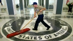In this March 3, 2005, file photo a workman quickly slides a dust mop over the floor at the Central Intelligence Agency headquarters in Langley, Va., near Washington. (AP Photo/J. Scott Applewhite, File)