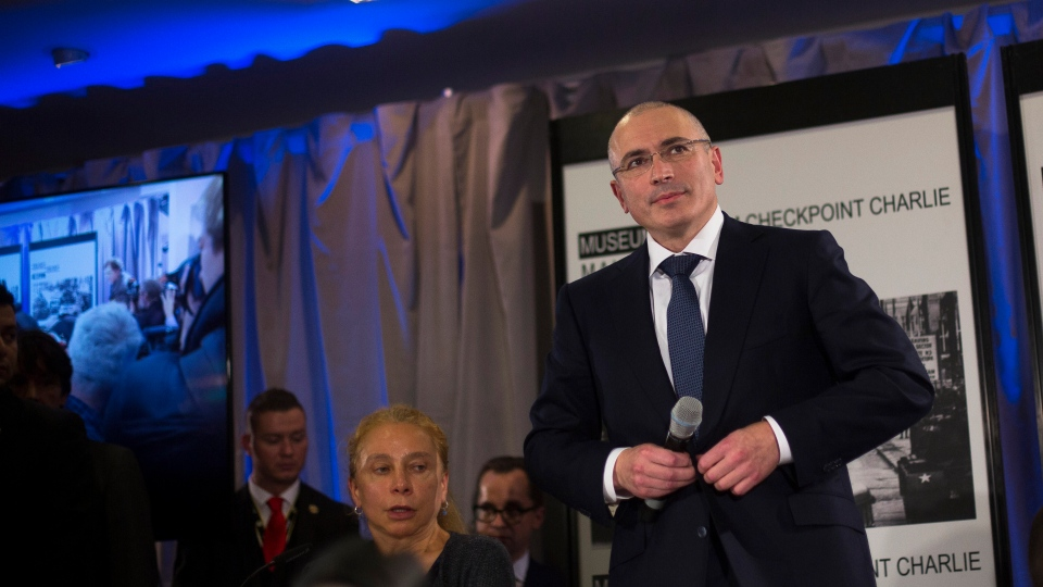 Mikhail Khodorkovsky, right, arrives at his first news conference after his release in Berlin, Sunday, Dec. 22, 2013. (AP / Markus Schreiber)