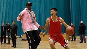 Former NBA basketball star Dennis Rodman plays one-on-one with north Korean player during a basketball practice session in Pyongyang, North Korea on Friday, Dec. 20, 2013. (AP / Kim Kwang Hyon)