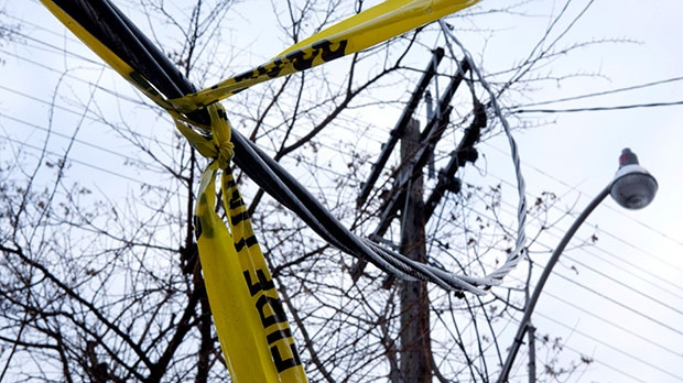 Power lines dangle on Sackville Street following an ice storm in Toronto on Monday, Dec. 23, 2013. (Matthew Sherwood / THE CANADIAN PRESS)