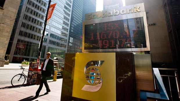 The numbers on the Scotiabank board in Toronto show the continued tumble of the TSX closing down 491.75 points on August 8, 2011. (Aaron Vincent Elkaim / THE CANADIAN PRESS)