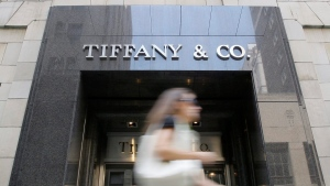 In this Aug. 26, 2009 photo, a pedestrian walks by a Tiffany & Co. jewelry store in Philadelphia. (AP / Matt Slocum)