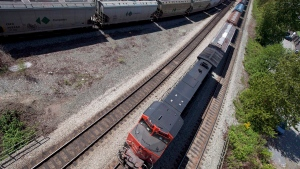 Two CN trains are seen at a rail intersection in North Vancouver, B.C., on May 10, 2012. (Jonathan Hayward/The Canadian Press)