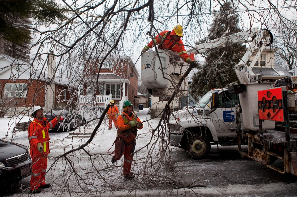 <b>150 Photos: Ice storm causes extensive damage </b> <br><br>Hundreds of thousands of people are dealing with power outages, dreadful driving conditions and damages due to an ice storm that has struck Eastern Canada. CTVNews.ca takes a look at a storm that is causing devastation during one of the busiest times of the year.<br><br>A crew from Stacey Electric, which was subcontracted to assist with restoring power following an ice storm in Toronto, works on a power line near Danforth Ave. and Victoria Park Ave. on Monday, Dec. 23, 2013. (Matthew Sherwood / THE CANADIAN PRESS)