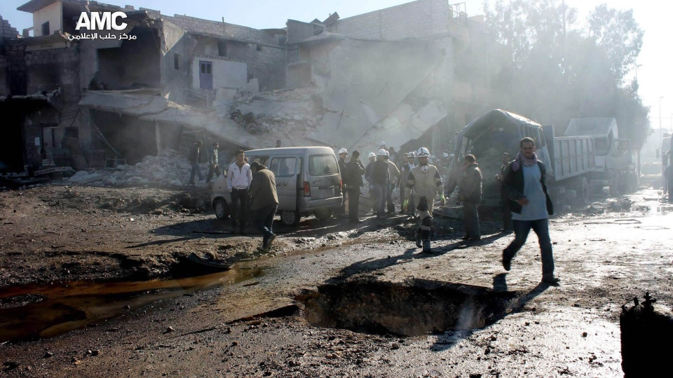 This citizen journalism image provided by Aleppo Media Center, AMC, which has been authenticated based on its contents and other AP reporting, shows a destroyed building after a Syrian aircraft pummeled masaken hanano, an opposition neighborhood in the northern city of Aleppo, Syria, Sunday, Dec. 22, 2013. (AP Photo/Aleppo Media Center AMC)