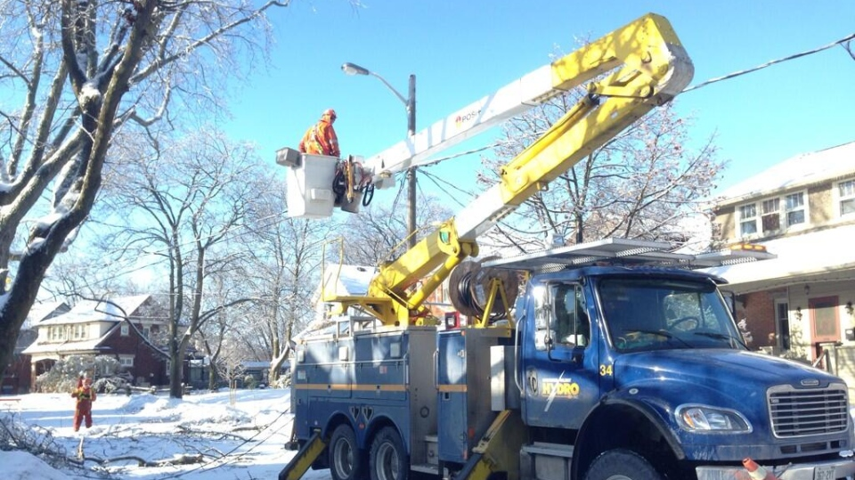 Kitchener Wilmot Hydro crews work to restore power on Pandora Ave. - Dec. 23, 2013 (Courtesy: Dan Lauckner)