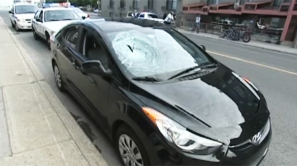 The sedan suffered a broken windshield, the driver suffered minor injuries to his arms.