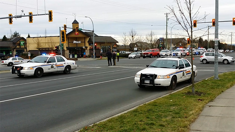 RCMP investigate following a reported shootout on Christmas day in Langley, after which a suspect sped away. Dec. 25, 2013 (CTV)