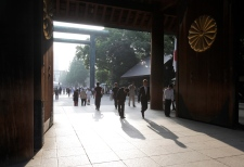 Worshippers bow at the Yasukuni Shrine in Tokyo