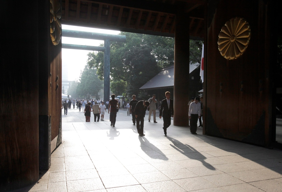 File Photo: Worshippers bow at the Yasukuni Shrine in Tokyo early Thursday morning, Aug. 15, 2013. The shrine honours 2.5 million war dead and remains a reminder of colonial and wartime aggression. (AP Photo/Shizuo Kambayashi)