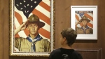 Andrew Garrison, 11, of Salt Lake City, looks over the Rockwell exhibition at the Church History Museum Monday, July 22, 2013, in Salt Lake City, Utah. (AP/Rick Bowmer)