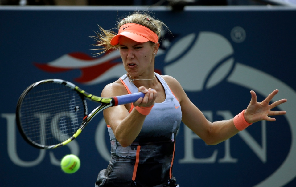 Eugenie Bouchard, of Canada, returns a shot to Angelique Kerber, of Germany, during the second round of the 2013 U.S. Open tennis tournament, Thursday, Aug. 29, 2013, in New York. (AP / David Goldman)