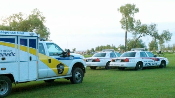 York Region Police and EMS are seen at the site of a drowning after man went overboard on Lake Simcoe in Pefferlaw, Ont., on Friday, Aug. 12, 2011.