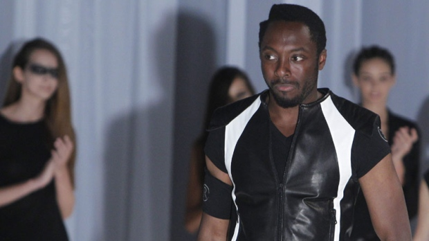 Will.I.Am of the hip hop group Black Eyed Peas wears a creation by Japanese fashion designer Rynshu as part of spring-summer 2012 men's fashion collection, in Paris, Sunday, June 26, 2011. (AP Photo/Jacques Brinon)