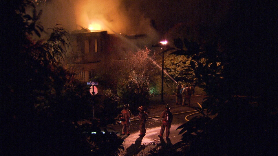 West Vancouver fire crews battle a massive blaze that devastated a $2.5-million home in the 2600-block of Chelsea Court Friday, Dec. 27, 2013. (CTV)