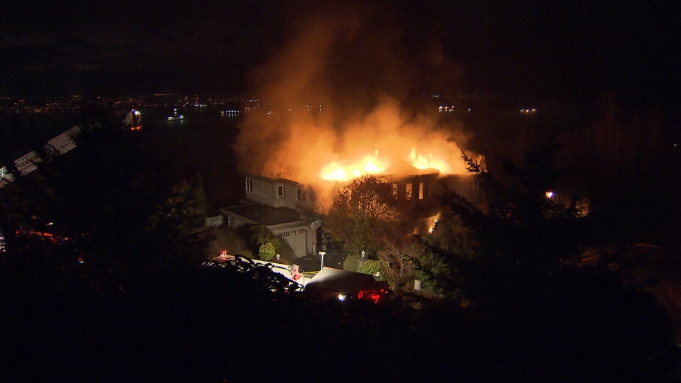 A massive fire engulfed a $2.5-million home in the 2600-block of Chelsea Court Friday, Dec. 27, 2013. (CTV)