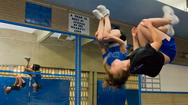 Some experts who studies brain injuries in youth sports worry that female-dominated sports like gymnastics and cheerleading are being overlooked.  (John Ulan / THE CANADIAN PRESS)