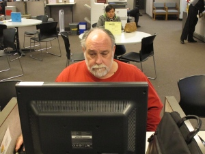 Richard Mattos, 59, looks for jobs at a state-run employment center in Salem, Ore., on Thursday, Dec. 26, 2013. Mattos is one of more than 1 million Americans who will lose federal unemployment benefits at year's end. (AP Photo/Jonathan J. Cooper)