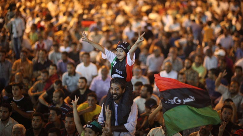 A girl makes the victory sign during a meeting to protest against the Libyan leader Moammar Gadhafi at the main square of the rebel-held town of Benghazi, Libya, late Thursday, Aug. 11, 2011. (AP / Alexandre Meneghini)