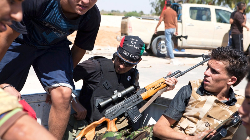 Libyan rebels are seen in the back of a pick-up truck headed for the frontline near Zawiya in western Libya, Saturday, Aug. 13, 2011. (AP / Giulio Petrocco)