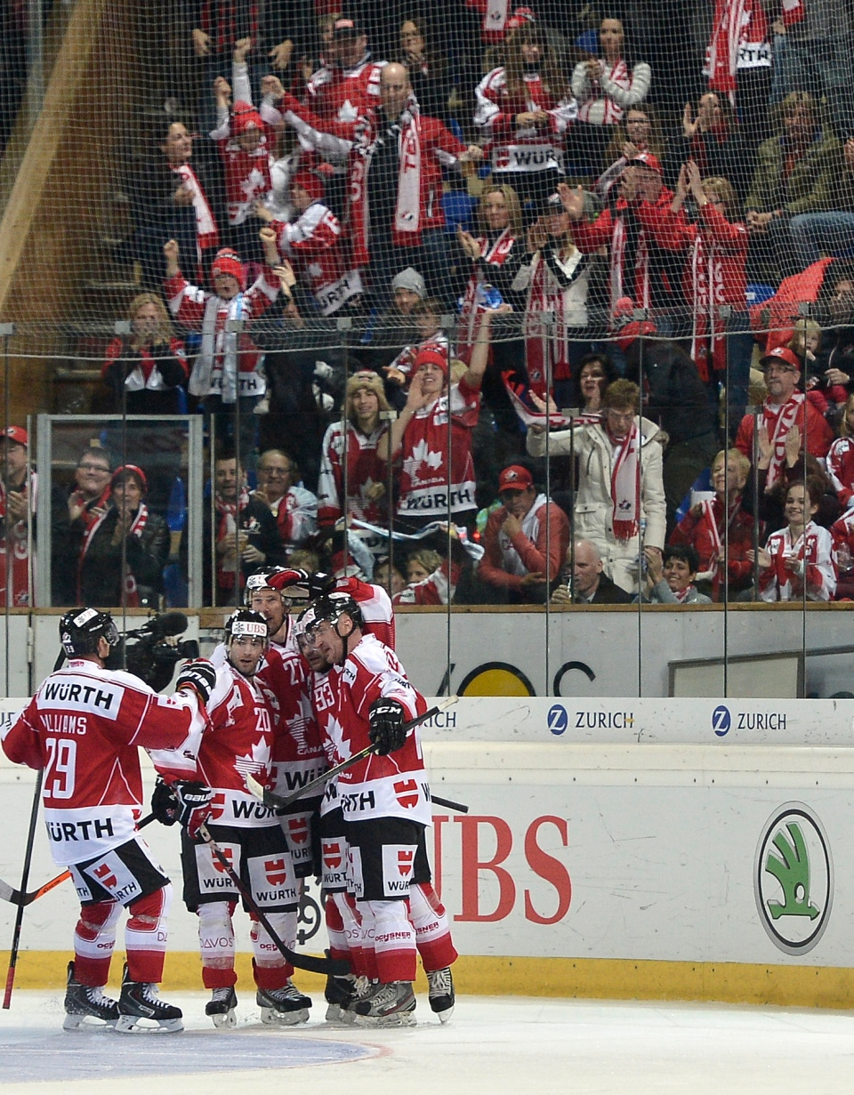Canada's players celebrate their fifth goal during the game between Team Canada and Rochester Americans at the 87th Spengler Cup ice hockey tournament, in Davos, Switzerland, Sunday, Dec. 29, 2013. (AP Photo / KEYSTONE/Peter Schneider)