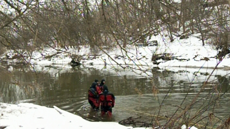 Ontario Provincial Police search for Robbie Reiner, 5, along the banks of the Nith River on Saturday, Dec. 28, 2013.