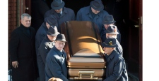 Pallbearers carry the coffin of reputed mafia boss