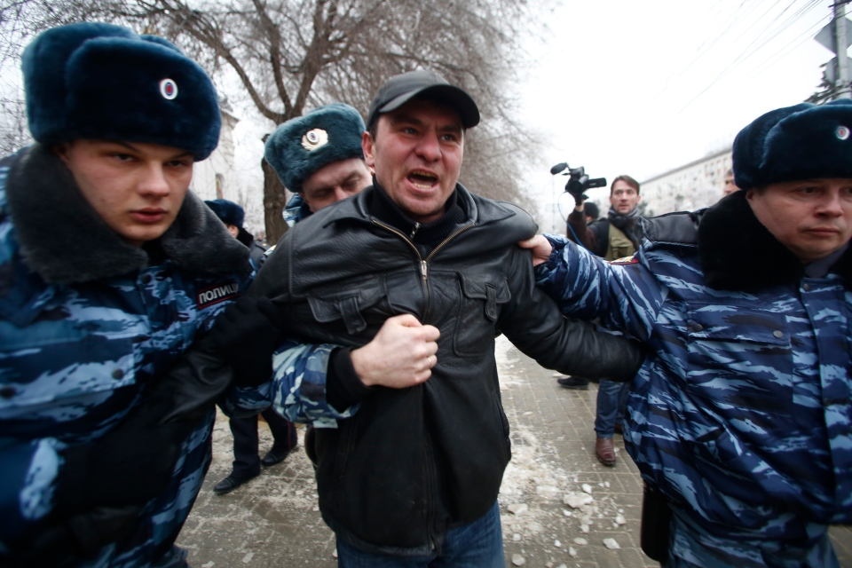 Police officers detain people who gathered for an unsanctioned event in downtown Volgograd, Russia, Monday, Dec. 30, 2013.  (AP / Denis Tyrin)