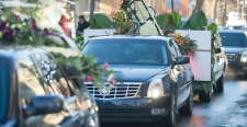 A cortege leaves a church following the funeral of