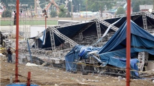 Indiana State Police and authorities survey the collapsed rigging and Sugarland stage on the infield at the Indiana State Fair in Indianapolis, Sunday, Aug. 14, 2011. (AP / Darron Cummings)