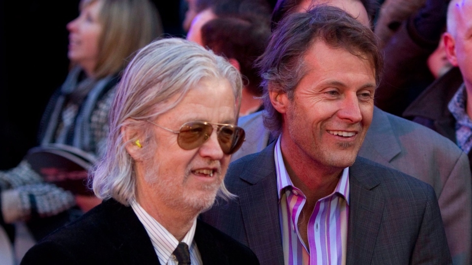 Jim Cuddy (right) and Greg Keelor of Blue Rodeo arrive on the red carpet at the 2011 JUNO Awards in Toronto on Sunday, March 27, 2011. (THE CANADIAN PRESS)