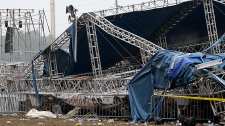 Indiana State Police and authorities survey the collapsed rigging and Sugarland stage on the infield at the Indiana State Fair in Indianapolis, Sunday, Aug. 14, 2011. Five people died in the stage collapse. (AP Photo/Darron Cummings)