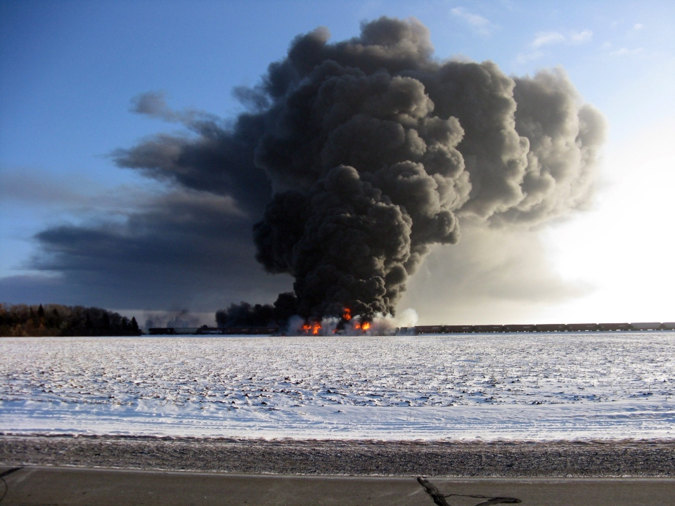 A train carrying Bakken oil derailed and caught fire west of Casselton, N.D., on Monday, Dec. 30, 2013. (AP / Ken Pawluk)