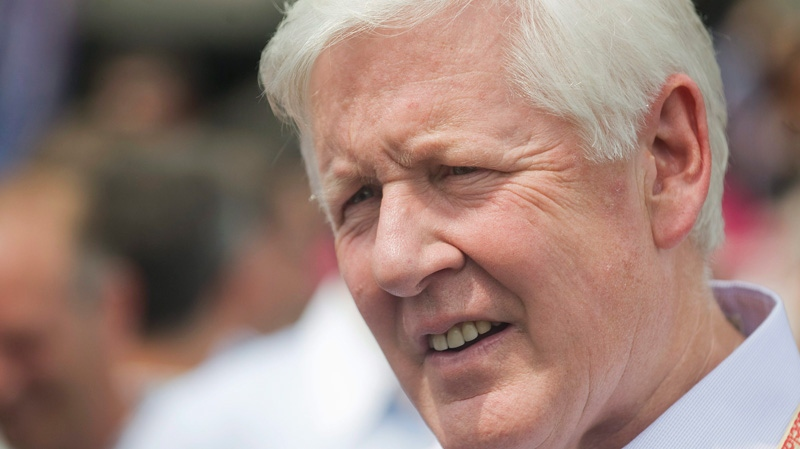 Liberal party interim leader Bob Rae speaks to reporters during the annual gay pride parade in Montreal, Sunday, Aug. 14, 2011. (Graham Hughes / THE CANADIAN PRESS)