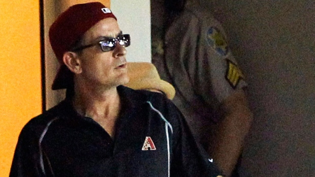 Actor Charlie Sheen stands during a baseball game between the Arizona Diamondbacks and the New York Mets, Sunday, Aug. 14, 2011, in Phoenix.  (AP / Ross D. Franklin)