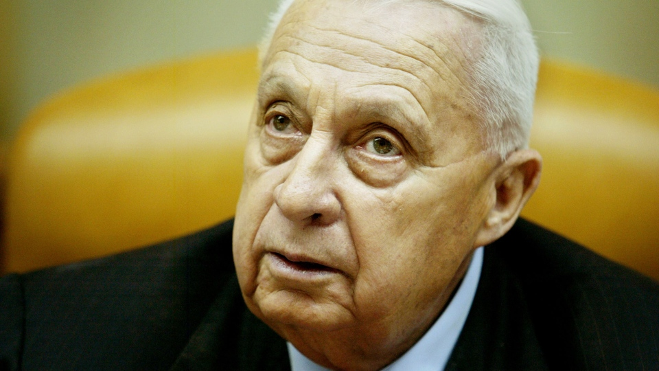 In this file photo, Ariel Sharon pauses during the weekly cabinet meeting in his Jerusalem office on Sunday Jan. 30, 2005. (AP / Oded Balilty)