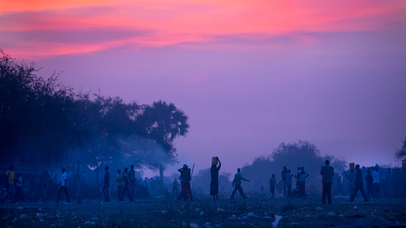 Displaced people who fled the recent fighting between government and rebel forces in Bor, South Sudan prepare to sleep in the open at night in the town of Awerial, South Sudan on Wednesday, Jan. 1, 2014. (AP Photo/Ben Curtis, File)