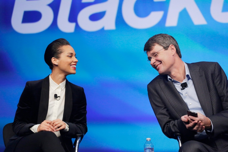 Thorsten Heins, then-CEO of BlackBerry, introduces singer Alicia Keys as a global creative director Wednesday, Jan. 30, 2013 in New York. (AP Photo/Mark Lennihan)