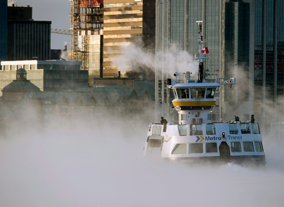 A Metro Transit ferry crosses the harbour through sea smoke, formed when very cold air moves over warm water, in Halifax on Thursday, Jan. 2, 2014.  (THE CANADIAN PRESS / Andrew Vaughan)