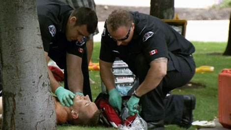 Paramedics assist a man who was injured in a shooting outside a casino in Kelowna, B.C. on Sunday, Aug. 14, 2011.