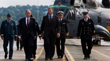 Defence Minister Peter MacKay, accompanied by Justice Minister Rob Nicholson, left, head to a ceremony in Halifax on Tuesday, Aug. 16, 2011. (Andrew Vaughan / THE CANADIAN PRESS)