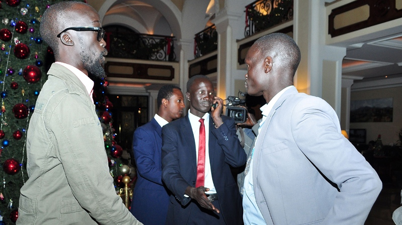 Grang Demebiar, left, the son of late Sudanese politician John Garang, who is in the group supporting ousted Vice President Riek Machar, as Grang Demebiar arrives with unidentified delegates in Addis Ababa, Ethiopia, Thursday, Jan. 2, 2014, to start peace talks.  (AP / Elais Asmare)