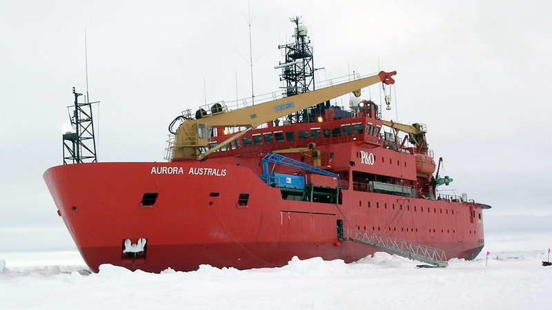 This handout photo provided by NSIDC, University of Colorado, taken in Oct. 2003, shows the icebreaker Aurora Australis awaiting the return of the scientific teams and their equipment in the Antarctic.