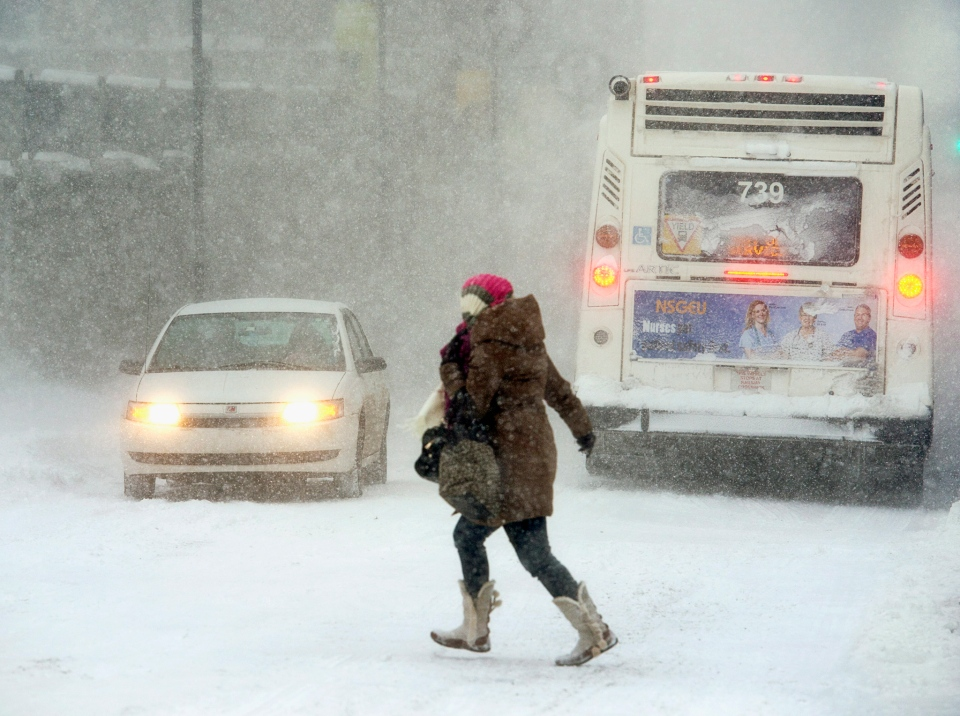 A pedestrian braves the blizzard conditions in Halifax on Friday, Jan. 3, 2014. (Andrew Vaughan / THE CANADIAN PRESS)