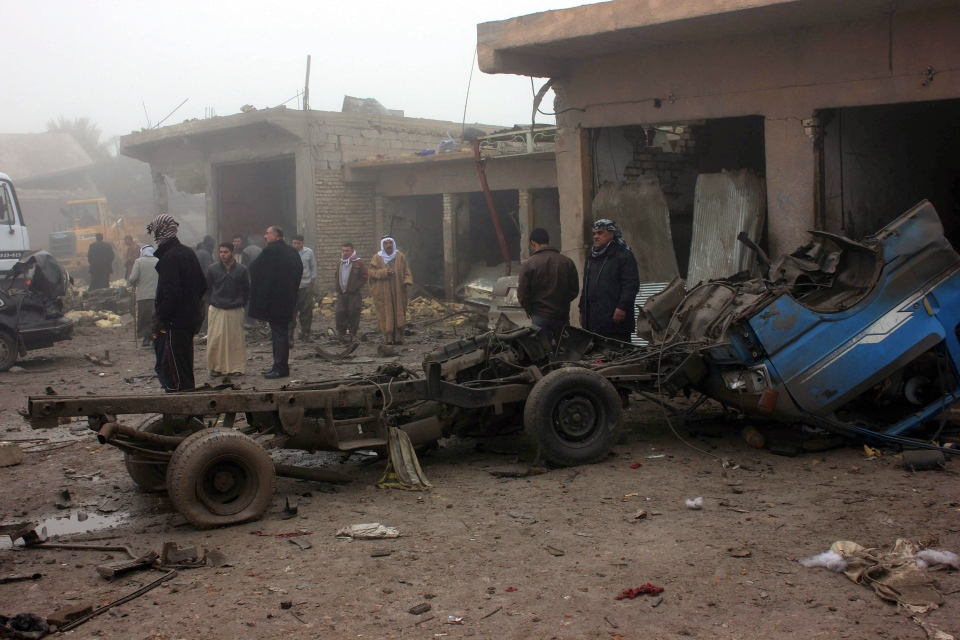 Civilians inspect the aftermath of a massive bomb attack in Balad Ruz, 70 kilometres northeast of Baghdad, Iraq, Friday, Jan. 3, 2014. (AP Photo)