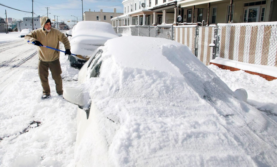 Gary Warrington, of Atlantic City, digs out his car out on Arctic Ave in Atlantic City, N. J., Friday, Jan. 3, 2014. (AP / The Press of Atlantic City, Edward Lea)