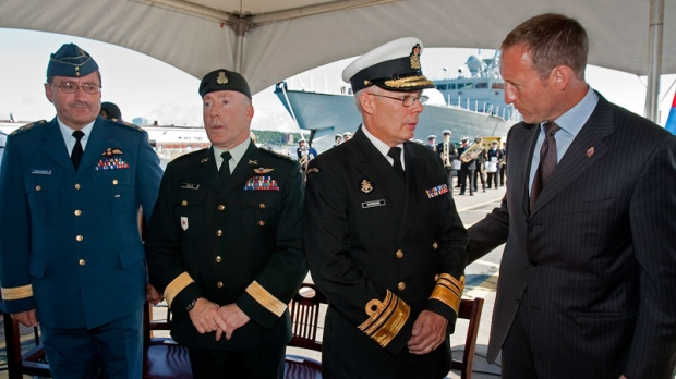 Lt.-Gen. Andre Deschamps, Chief of the Air Staff, Lt.-Gen. Peter Devlin, Chief of the Land Staff and Vice-Admiral Paul Maddison, Chief of the Maritime Staff, left to right, chat with Defence Minister Peter MacKay at a ceremony in Halifax on Tuesday, Aug. 16, 2011. (Andrew Vaughan / THE CANADIAN PRESS)