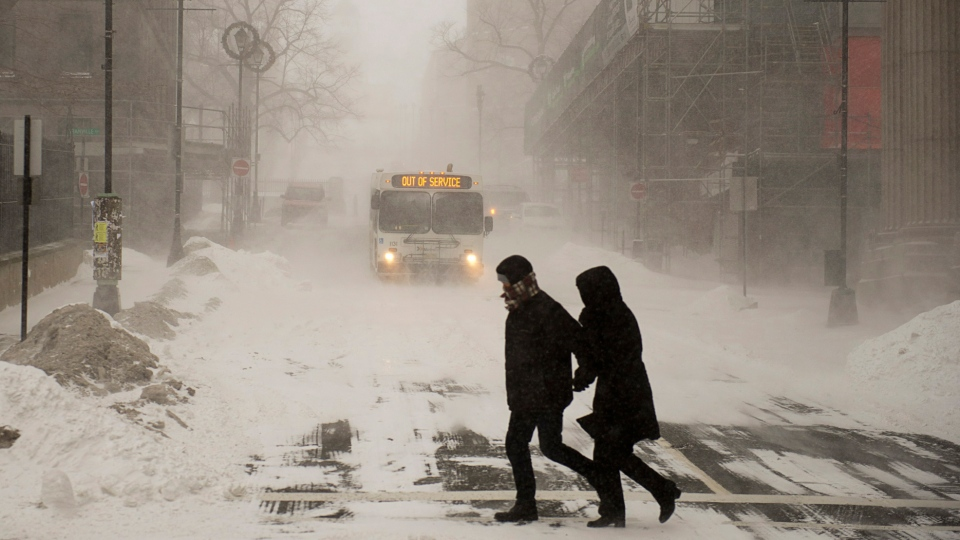 Pedestrians brave the blizzard conditions in Halifax on Friday, Jan. 3, 2014. (Andrew Vaughan / THE CANADIAN PRESS)