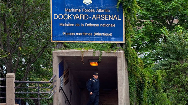 A sailor walks under signage at Maritime Forces Dockyard in Halifax on Monday, Aug. 15, 2011. Defence Minister Peter MacKay is expected to announce a name change to the Royal Canadian Navy, the Royal Canadian Air Force and Canadian Army for the armed forces. (Andrew Vaughan / THE CANADIAN PRESS)