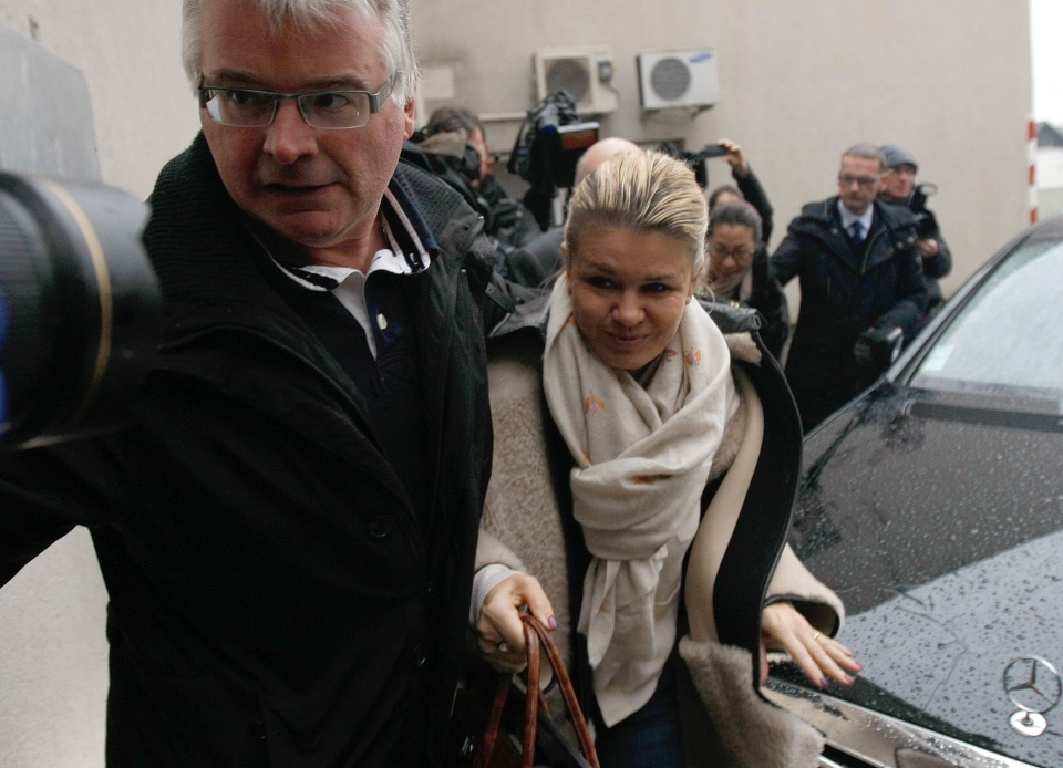 Michael Schumacher's wife, Corinna, arrives at the Grenoble hospital where former seven-time Formula One world champion Schumacher is being treated after sustaining a head injury during a ski accident in French Alps, Saturday, Jan. 4, 2014. (AP / Claude Paris)